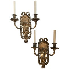 Pair of E.F. Caldwell Polished Silver Two-Arm Neoclassical Bow-Top Sconces