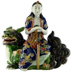 Japan, Porcelain Statuette of Manjushri on Buddhist Lion, circa 1900