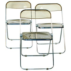 Chrome and Smoked Grey Lucite Plia Folding Chairs by G. Piretti for Castelli