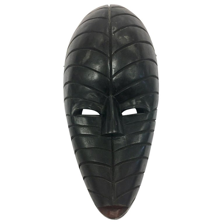 Decorative African Mid-Century Modernist Carved Tribal Mask Sculpture from Ghana