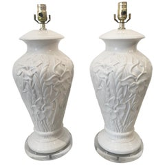Pair of White Ceramic Table Lamps with Raised Floral Pattern on Lucite Bases