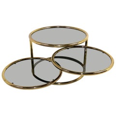 Sleek Milo Baughman Style Brass and Glass Swiveling Coffee Table