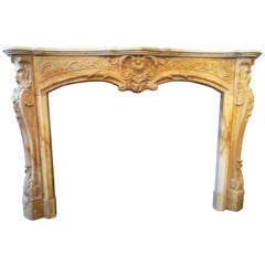 Regence Style Yellow Siena Marble Fireplace Mantel, 19th Century. Neptune Head