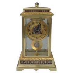 French Napoleon III Brass Four Glass and Champleve Mantel Clock
