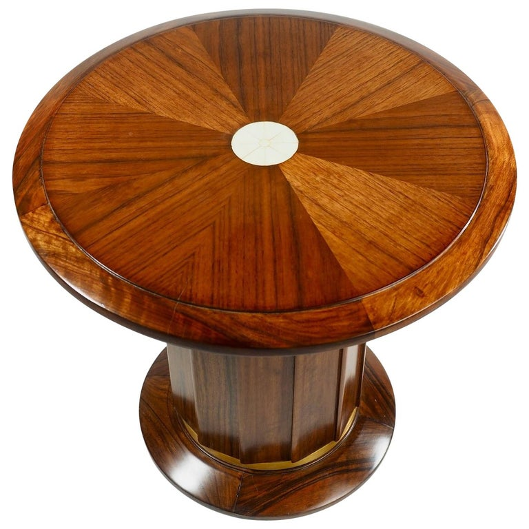 French modernist Art Deco side/end table in rosewood and bronze with inlaid bone top. Documented (this table) in Dominique/ Andre Domin & Marcel Genevriere, by Felix Marcilhac, les Editions de l'Amateur, 2008, page 54. See last photo. Restored and
