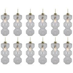 Set of Twelve Large Midcentury Pendants, in Glass and Brass Europe 1970s