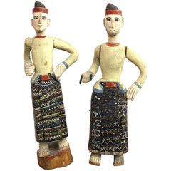 South-East Asian Carved and Painted Wood Figures of Men in Sarongs