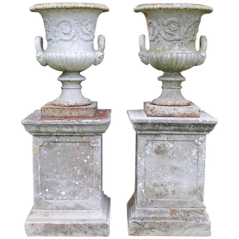 Pair of English 19th Century Cast Iron Garden Urns on Stone Plinths