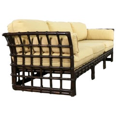 Brown Jordan Windowpane Dark Brown Rattan Sofa with Straw Colored Cushions