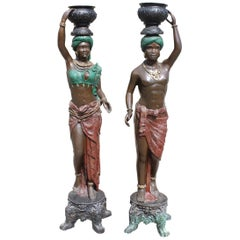 Pair of Polychrome Bronze Blackamore Sculptures Carrying Urns