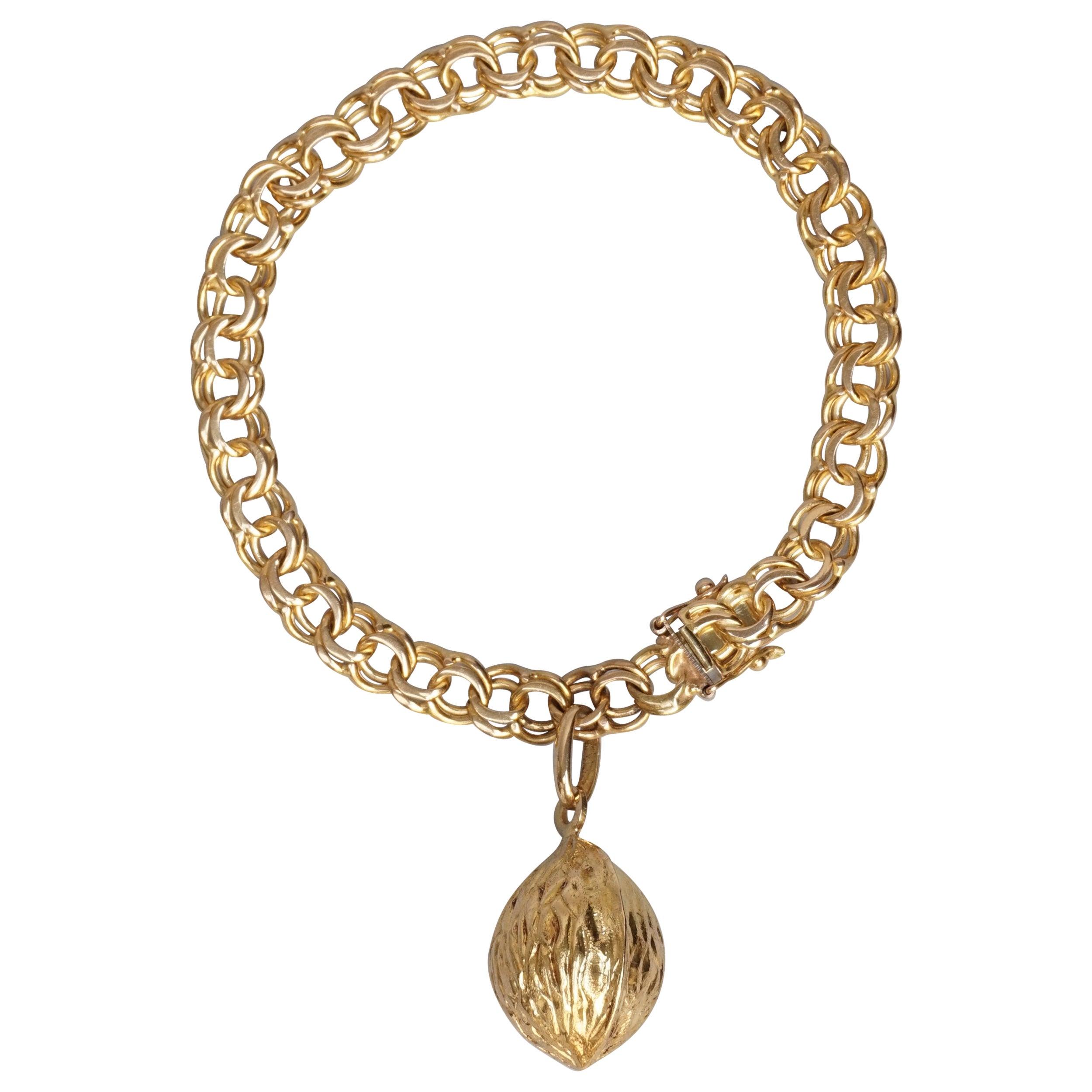 389f51e7ab5e6 1950s Classic Double Link 18-Karat Gold Charm Bracelet with Nutmeg Charm