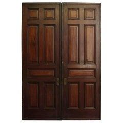 1910 Pair of Wheeled Seven Raised Panel Pocket Quarter Sawn Oak Doors