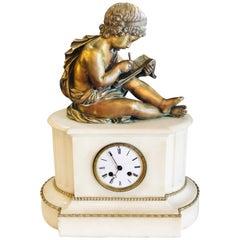 19th Century Figural School Boy Bronze Sitting Atop a Marble Mantle Clock Base