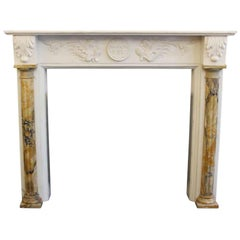 1970s Never Used Marble Doric Mantel with Figural Detail and Acanthus Leaves