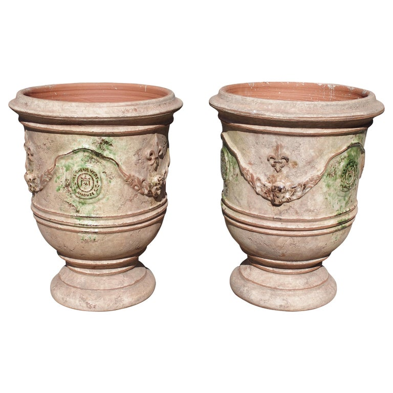 Pair of Mid Sized Distressed Terra Cotta Planters from Anduze, France