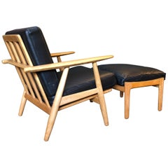 Pair of Hans Wegner ge240 Cigar Chairs with Ottomans. Reupholstered