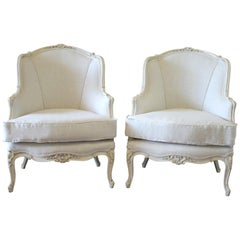 Pair of Painted White Louis XV Style Linen Upholstered Bergère Chairs