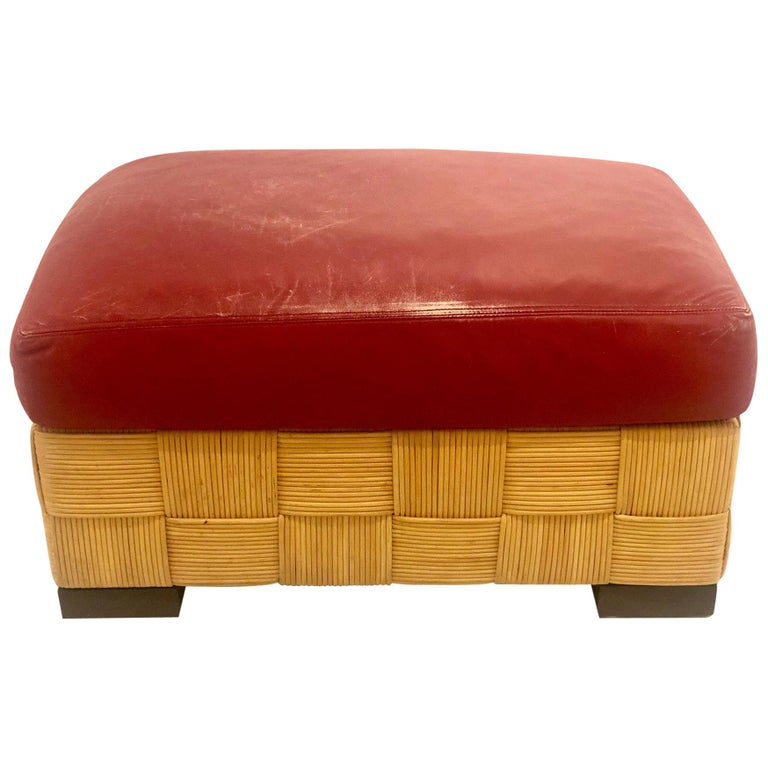 Wonderful designed, these Island inspired wicker ottomans by John Hutton, are heavy and well constructed. With nicely worn red leather cushions and dark walnut finish feet, incredible construction and quality, the cushions are nicely worn as seen on