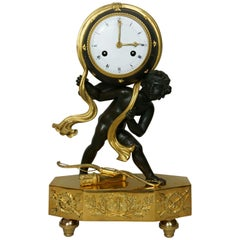 19th Century French Empire Figural Gilt and Patinated Bronze Cupid Mantel Clock