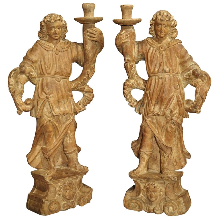 Beautiful Pair of Stripped 17th Century Italian Torchbearer Candleholders For Sale