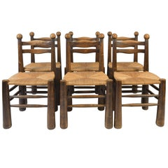 Set of Six Straw Seat and Oak Dining Chairs in the Style of Jean Royère