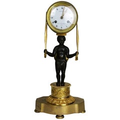 19th Century French Empire Gilt and Patinated Bronze JB Blanc Mantel Clock