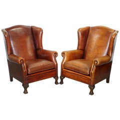 Pair of Vintage Sheepskin Leather Aged Brown Wingback Armchairs Carved Wood Legs