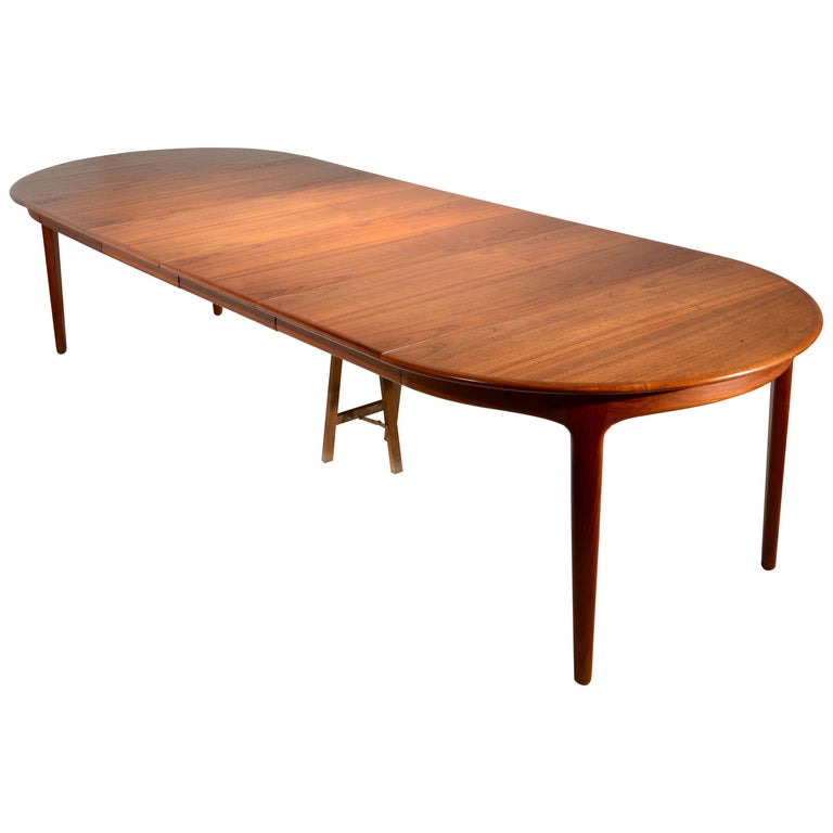 Extra Long Danish Teak Round Table with 4 Extensions by Henning Kjaernulf