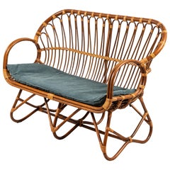 Curved Wicker Settee With Newly Upholstered Green Waxed Canvas Cushion