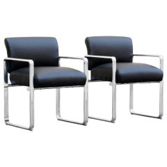 Pair of 1960s Modern Polished Aluminum and Leather Armchairs
