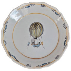 "Nevers 'France' Faience Plate with ""Balloon"" Decoration, 18th Century"