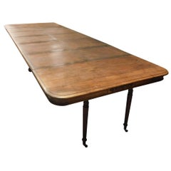 20th Century Antique Extendable Table with Small Wheels