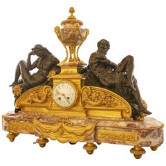 French Louis XVI Style Marble and Bronze Figural Clock