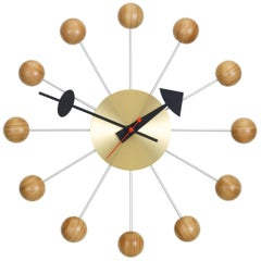 Vitra Ball Wall Clock in Wood and Brass with Black Hand by George Nelson