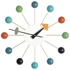 Vitra Ball Wall Clock in Multicolor Wood with Black Hand by George Nelson