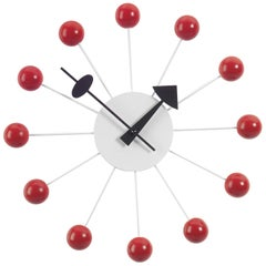 Vitra Ball Wall Clock in Red and White with Black Hand by George Nelson