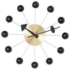 Vitra Ball Wall Clock in Black & Brass with Black Hand by George Nelson