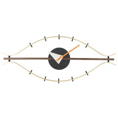 Vitra Eye Wall Clock in Brass and Walnut with Orange Hand by George Nelson
