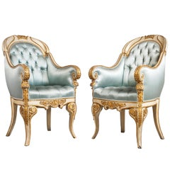 Four White Painted and Giltwood Armchairs