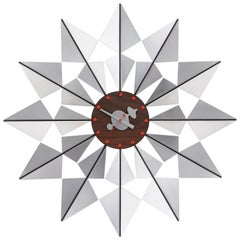 Vitra Flock of Butterflies Wall Clock in Aluminum and Wood by George Nelson
