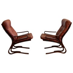 Pair of Oddvin Rykken Mid-Century Modern Leather Lounge Chairs