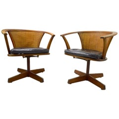 Pair of Mid Century Oak and Cane Swivel Chairs