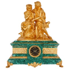French Gilt Bronze and Malachite Clock after Moreau