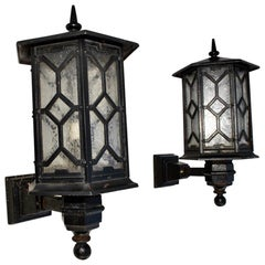 Elegant and Rare Large Pair of 1920s Cast Iron Outdoor Sconces
