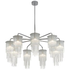 GS Chandelier, 9 Arm Chandelier with Glass Tiers byTom Kirk in Chrome Finish