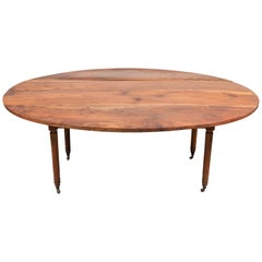 Early American Oval Mahogany Drop Leaf Table with Turned Legs on Casters