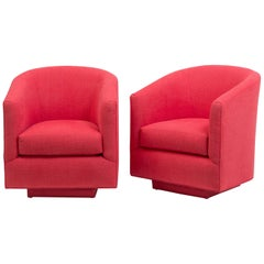 Pair of Coral Linen Upholstered Swivel Tub Chairs