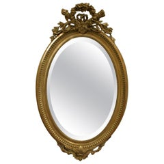 19th Century French Gold Gilt Oval Mirror with Bow and Arch
