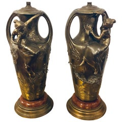 Pair of Art Nouveau Figural Urns Mounted as Lamps
