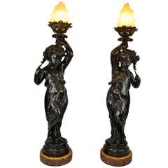 Pair of Figural Bronze Torcheres